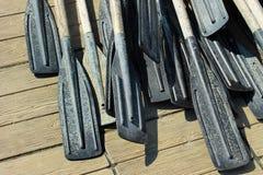 Old plastic oars. Old black plastic oars on wooden floor Royalty Free Stock Photos