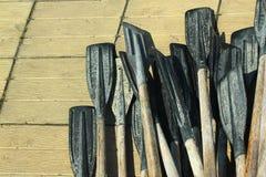 Old plastic oars on wooden floor.  Stock Photos