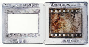 Old plastic slide film mount frame. Old vintage 35mm slides, grungy and dirty on white background with free space for your pics Royalty Free Stock Photography