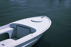 Old plastic small fishing boat in good condition Stock Photos