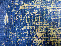 Old Plastic Surface Background. A background with a close view of an old worn plastic surface of blue and yellow color Stock Images
