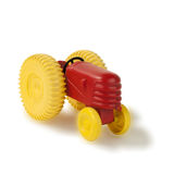 Old plastic toy tractor front Stock Image