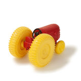 Old plastic toy tractor rare. On white Royalty Free Stock Image