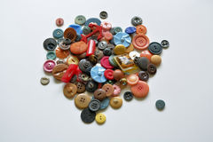 Old plastic vintage buttons on white background Stock Photography