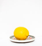 Old plate with lemon Royalty Free Stock Image
