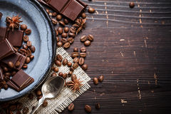 Old plate with teaspoon and chocolate Stock Photo
