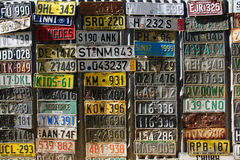 Old plates. Old number plates on the wall in Australia royalty free stock photo