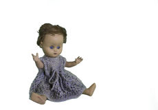 Old play doll with short hair and hands in the air. isolated Royalty Free Stock Photos