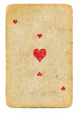 Old playing card ace of hearts paper background Royalty Free Stock Photo