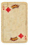 Old playing card king of diamonds background with crown. Old used playing card king of diamonds paper background with crown royalty free stock images