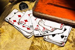 Old playing cards on dirty surface stock photos