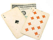 Old playing cards and dollar Royalty Free Stock Images