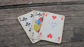 Old playing cards on wooden background royalty free stock photo