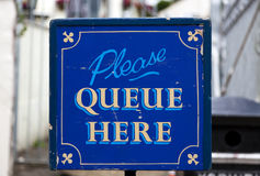 Old Please Queue Here Sign Royalty Free Stock Photo