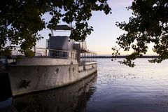 An old pleasure boat on the river in time for a beautiful sunrise. Recreation. Travels. Fishing Stock Images