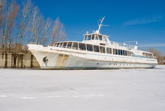 An old pleasure boat on a winter river. Royalty Free Stock Photos