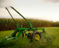 Old Plow. An old plow resting near an Iowa cornfield in the fall Stock Images