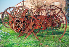 Old plow on green grass Royalty Free Stock Photo