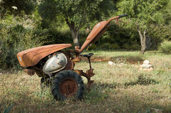 Old plow. Old rusty plow in the field Stock Image