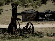 Old plow and shack in ruin royalty free stock photos