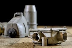 Old plug and socket high voltage. Old electrical accessories. Wo Royalty Free Stock Photo