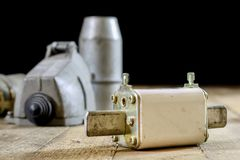Old plug and socket high voltage. Old electrical accessories. Wo Royalty Free Stock Image