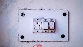 White Old rustic Electronic Socket in the wall stock image