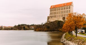 The old Plumlov castle builded in Baroque architecture style in Plumlov town on the pond bank, Moravia, Czech Republic royalty free stock image