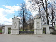 Old Plunge town park gate, Lithuania. Old white beautiful Plunge town park gate, Lithuania royalty free stock photos