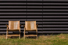 Old plywood chairs in the sun Royalty Free Stock Photo