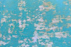 Old plywood with remains of turquoise paint as a background Royalty Free Stock Images