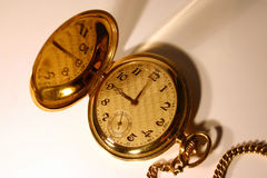 Old pocket watch. Old gold pocket watch showing 9 o'clock Stock Photo