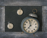 Old pocket watch and alarm clock Royalty Free Stock Photos