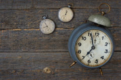 Old pocket watch and alarm clock Royalty Free Stock Images