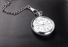 Old pocket watch in a black Stock Image