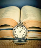 Old pocket watch and book Stock Image