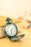 Old pocket watch and book Royalty Free Stock Photography