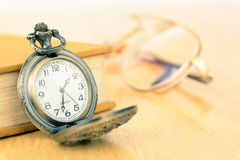 Old pocket watch and book Royalty Free Stock Images