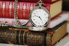 Old pocket-watch and books Royalty Free Stock Images