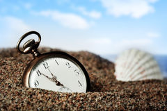 Old pocket watch buried in sand Stock Photography