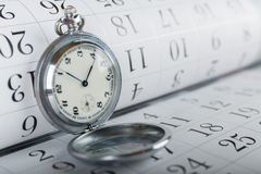 Old pocket watch and calendar Royalty Free Stock Photography