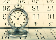 Old pocket watch and calendar Royalty Free Stock Image