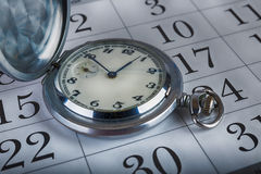 Old pocket watch and calendar Royalty Free Stock Images