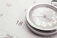 Old pocket watch on calendar page. vintage, black&white Royalty Free Stock Image