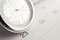 Old pocket watch on calendar page. vintage, black&white Royalty Free Stock Images