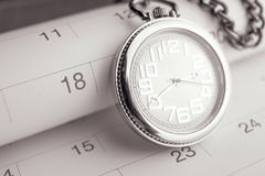 Old pocket watch on calendar page. vintage, black&white Royalty Free Stock Photos