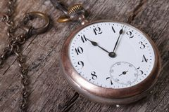 Old pocket watch on a chain Stock Images