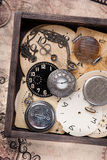 Old pocket watch and clock face in vintage box Stock Photo