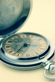 Old pocket watch. Close up of old pocket watch in vintage picture style Stock Photography