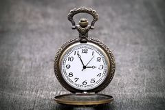 Old pocket watch. On dark gray table background Royalty Free Stock Image